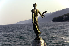 Lady with Seagull. Statue of a Lady with Seagull, symbol of Opatija, the city resort in Croatia Stock Photo