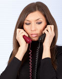 Lady secretary speaking on the phone Stock Image