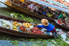Lady selling fruit from her boat at Floating Market, Royalty Free Stock Image