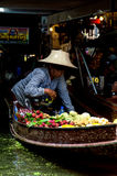 Lady selling fruit from her boat at Floating Market, Royalty Free Stock Photo