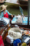 Lady selling fruit from her boat at Floating Market, Stock Photography