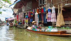 Lady selling fruit from her boat at Floating Market, Stock Image