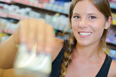 Lady serving blurred packet cigarettes Royalty Free Stock Image