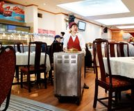 A lady serving in a dim sum restaurant royalty free stock photo