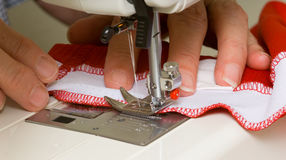 Lady at a Sewing Machine Stock Photo