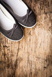 Lady shoes on wooden deck Stock Photo