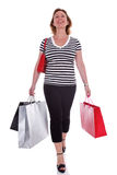 Lady shopper carrying shopping bags . Stock Image