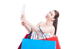 Lady shopper taking selfie with tablet and being funny Royalty Free Stock Images