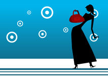 Lady with shopping bag. On circular background Royalty Free Stock Photography