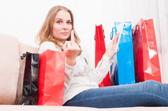 Lady shopping online and showing obscene gesture Royalty Free Stock Photo