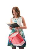 A lady at shoppings reading a book Stock Images