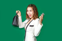 Lady show off her new purse and mobile phone. Asian teen hold cell phone and handback leather to show materialism in generation Stock Images