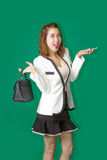 Lady show off her new purse and mobile phone. Asian teen hold cell phone and handback leather to show materialism in generation and dream concept Stock Photography