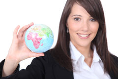 Lady showing a globe Stock Images