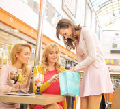 Lady showing her girlfriends some shopping Royalty Free Stock Photography
