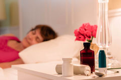 Lady sick in bed Stock Images