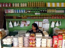 A lady sits in her sweet snacks and delicacy store in a tourist spot in Tagaytay City, Philippines. TAGAYTAY CITY, PHILIPPINES - APRIL 11, 2017: A lady sits in Royalty Free Stock Photos
