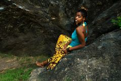 Lady sits on rock. African american sits on rock royalty free stock image