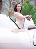 Lady sitting in a car Royalty Free Stock Image