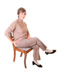 Lady sitting on chair. Stock Photography