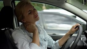 Free Lady Sitting In Car Feeling Neck Pain, Sedentary Life, Lack Of Physical Activity Stock Images - 137527004