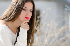 Lady sitting outside with passive look Royalty Free Stock Photos