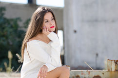 Lady sitting outside with passive look Stock Photo