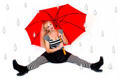 Lady Sitting with Red Umbrella and Faux Raindrops Royalty Free Stock Photos