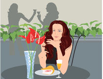 Lady sitting in a restaurant  Royalty Free Stock Photos