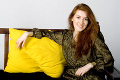 Lady sitting on a sofa Stock Photos