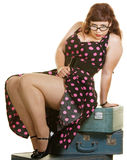Lady Sitting on Suitcases. Sexy plus size woman sitting on stack of suitcases Royalty Free Stock Photo