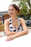 Lady sitting at a table 2. Pretty gal sitting at an outdoor patio Royalty Free Stock Image