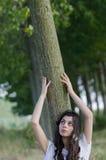 Lady sitting under the tree Stock Image
