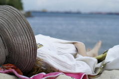 Lady sleeping on beach Stock Images