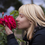Lady  smelling a rose ih a baroque park Stock Photo