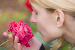 Lady  smelling a rose ih a baroque park Stock Photos