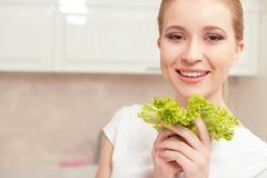 Lady smiles while holding salad royalty free stock photography