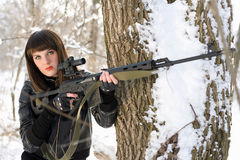 Lady with a sniper rifle. Portrait of young lady with a sniper rifle Stock Images