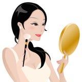 Lady som gör makeup Arkivfoton