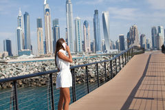 Lady speaking by phone. Enjoying view of Dubai city Stock Images