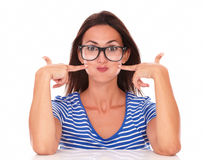 Lady with spectacles making a funny face Royalty Free Stock Image