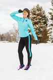 Lady spending free time in park. Winter holidays, sporty people concept. Lady spending free time in park. Sporty girl wearing sunglasses enjoying good wintry Royalty Free Stock Photos