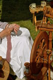 Lady at the spinning wheel Royalty Free Stock Photography
