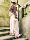 Lady on the stairs Royalty Free Stock Images