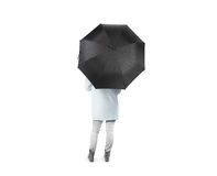 Lady stand backwards black blank umbrella opened mockup, clipping path Stock Photography