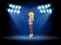 A lady standing in the middle of the stage with spotlights Royalty Free Stock Image