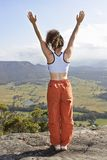 Lady standing on the mountain top Stock Photo
