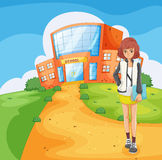 A lady standing outside the school building Royalty Free Stock Images