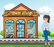 A lady standing beside the pawnshop Royalty Free Stock Image