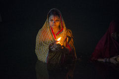Lady standing in river water at chhat puja Stock Image